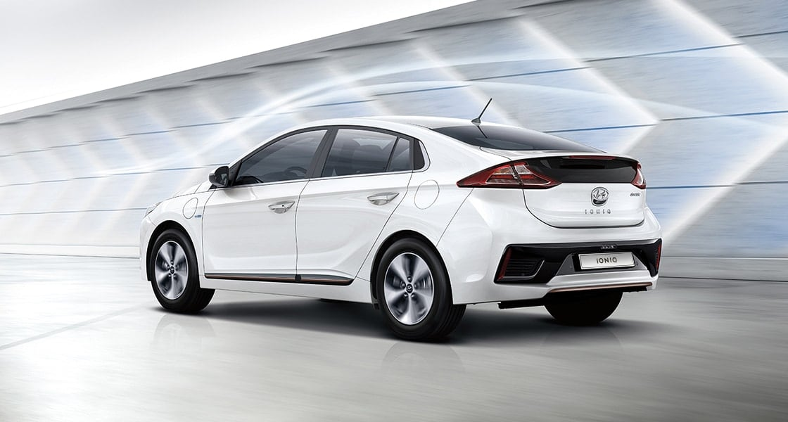 Side rear view of white Ioniq electric with aerodynamic design